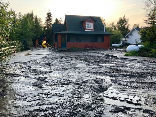 After the hamlet of Marten Beach flooded on July 25, 2019, the water left a muddy mess in its wake. (Caroline Wagenaar - image credit)