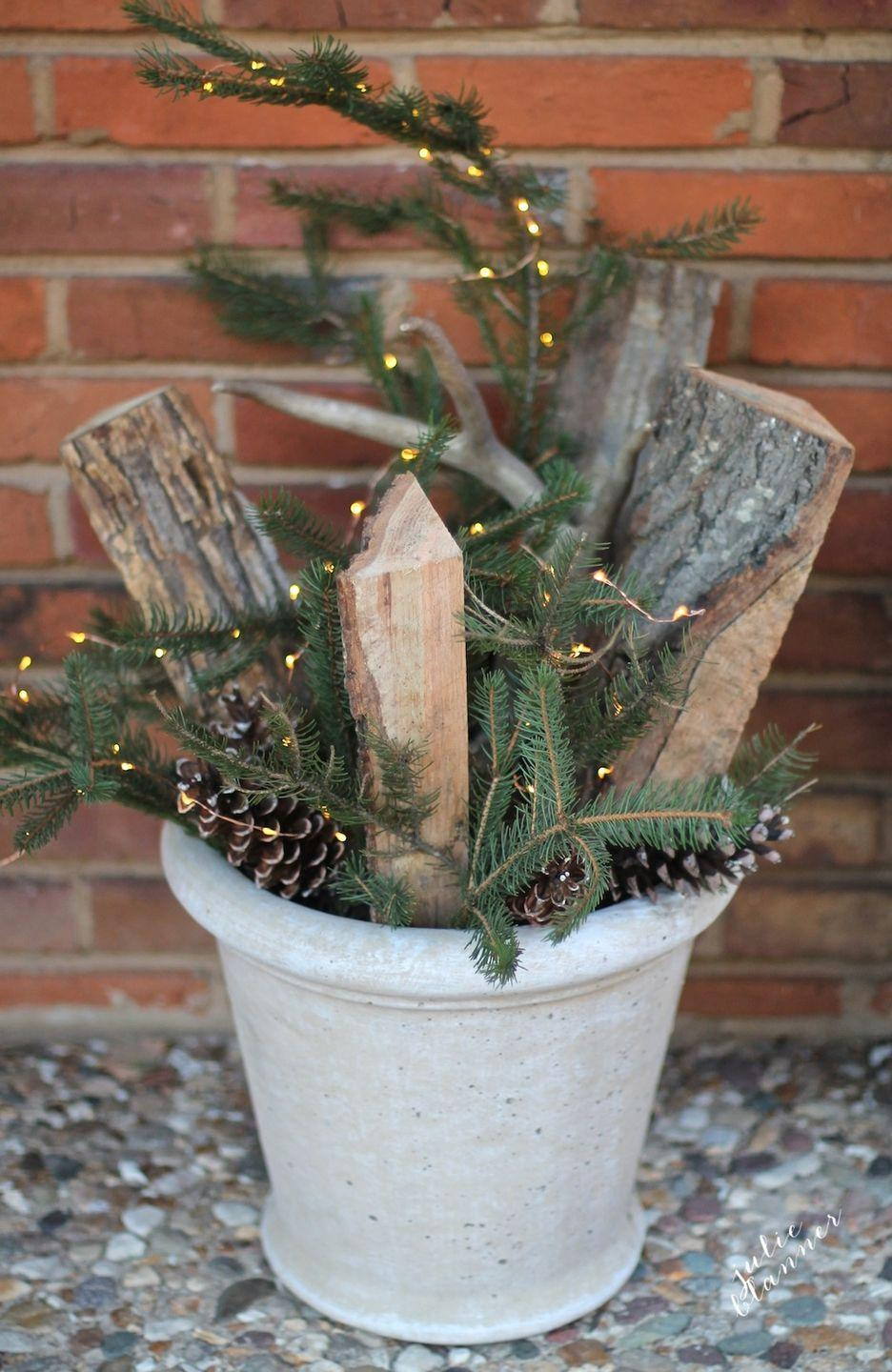 "<p>Turn a common winter scene—firewood, evergreen branches, and pinecones—into a dazzling display with some string lights.</p><p>See more at <a href=""http://julieblanner.com/fall-to-winter-decorations/"" rel=""nofollow noopener"" target=""_blank"" data-ylk=""slk:Julie Blanner"" class=""link rapid-noclick-resp"">Julie Blanner</a>. </p>"