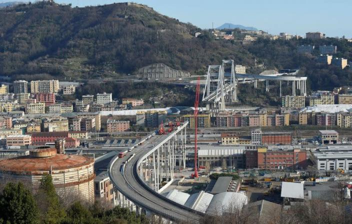 FILE PHOTO: Construction workers dismantle the collapsed Morandi Bridge in Genoa