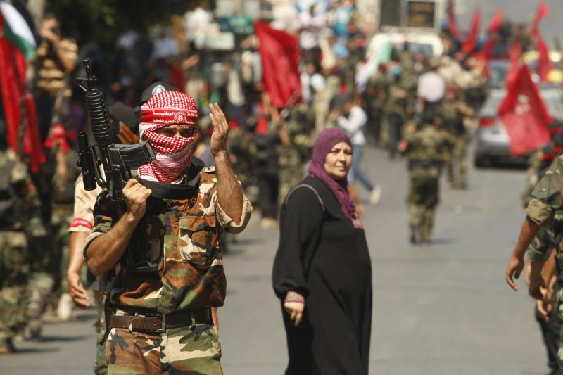 A Palestinian militant from the Democratic Front for the Liberation of Palestine (DFLP) gestures during a military show in Gaza City