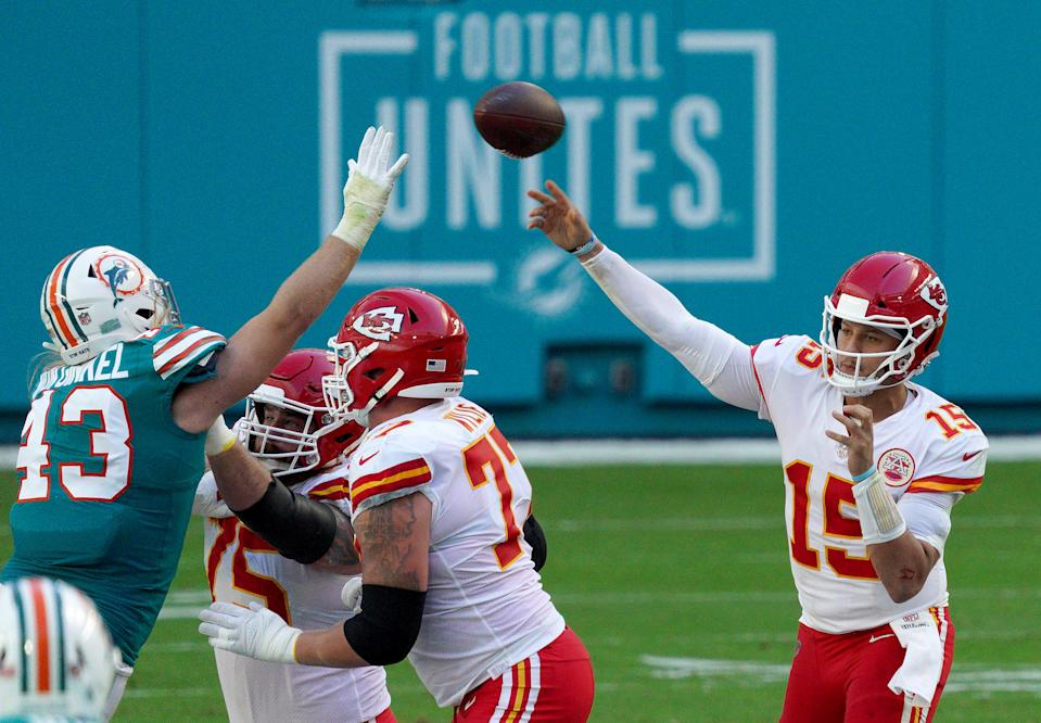 Andrew Van Ginkel #43 of the Miami Dolphins defends as Patrick Mahomes #15 of the Kansas City Chiefs passes the ball during the first half of the game at Hard Rock Stadium on December 13, 2020 in Miami Gardens, Florida. (Photo by Mark Brown/Getty Images)