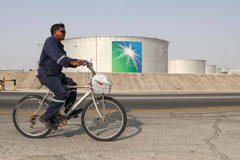 EASTERN PROVINCE, SAUDI ARABIA - OCTOBER 12, 2019: A worker rides a bicycle by oil tanks at an oil processing facility of Saudi Aramco, a Saudi Arabian state-owned oil and gas company, at the Abqaiq oil field. On 14 September 2019, two of the major Saudi oil facilities, Abqaiq and Khurais, suffered massive attacks of explosive-laden drones and cruise missiles; the Houthi movement, also known as Ansar Allah, claimed responsibility for the attacks. Stanislav Krasilnikov/TASS (Photo by Stanislav Krasilnikov\TASS via Getty Images)