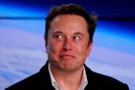 FILE PHOTO: SpaceX founder Musk reacts at a post-launch news conference in Cape Canaveral