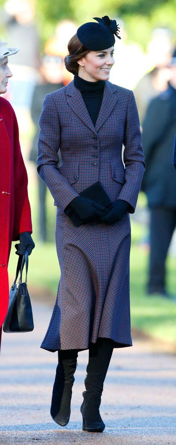 <p>Wearing a matching Michael Kors coat and skirt during a memorial church service. </p>