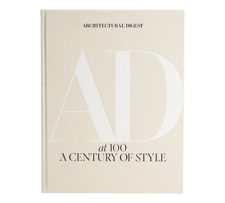 <p>If you're not sure where to begin with decorating your coffee table, start with a cool book or two. The <strong><span>Architectural Digest: A Century of Style Coffee Table Book</span> ($100)</strong> has that minimal look that'll blend right in. Plus, it'll be fun for guests to look through.</p>