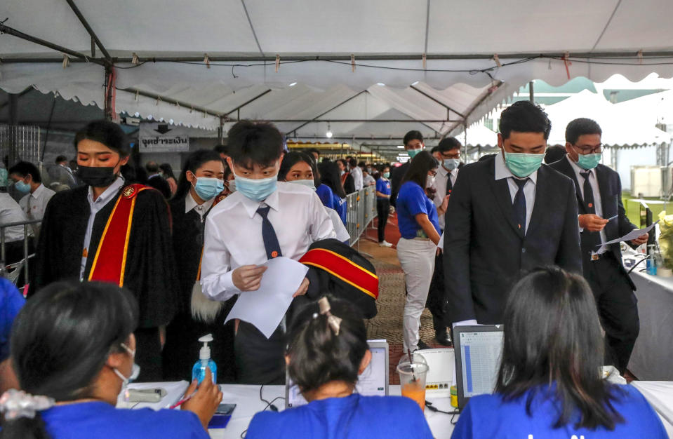 University students arrive for their graduation ceremony at the Thammasat University, Friday, Oct. 30, 2020, in Bangkok, Thailand. (AP Photo/Sakchai Lalit)