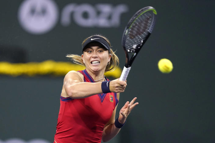 Paula Badosa, of Spain, hits a forehand to Angelique Kerber, of Germany, at the BNP Paribas Open tennis tournament Thursday, Oct. 14, 2021, in Indian Wells, Calif. (AP Photo/Mark J. Terrill)