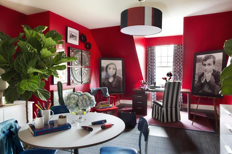 In this undated publicity photo provided by Brian Patrick Flynn, Designer, Brian Patrick Flynn, turned a disorganized catch-all room into a clean and colorful creative space as shown here, decorated solely with random leftover pieces pulled from storage. Flynn uses bold color as a backdrop, then unites the disparate pieces with touches of the same accent color. (AP Photo/Brian Patrick Flynn, Sarah Dorio)