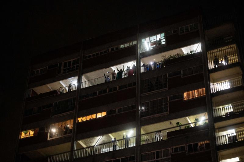 "Residents of a building across the ""20 de Noviembre"" hospital sing and wave lights to praise medical staff and patients in Mexico City, on April 28, 2020, amid the novel coronavirus pandemic. - Latin America is like ""Europe six weeks ago"" in relation to the advance of COVID-19, so an increase in the number of cases is expected in the coming weeks, warned on April 28 the deputy director of the Pan American Health Organization (PAHO), Jarbas Barbosa. (Photo by PEDRO PARDO / AFP) (Photo by PEDRO PARDO/AFP via Getty Images)"
