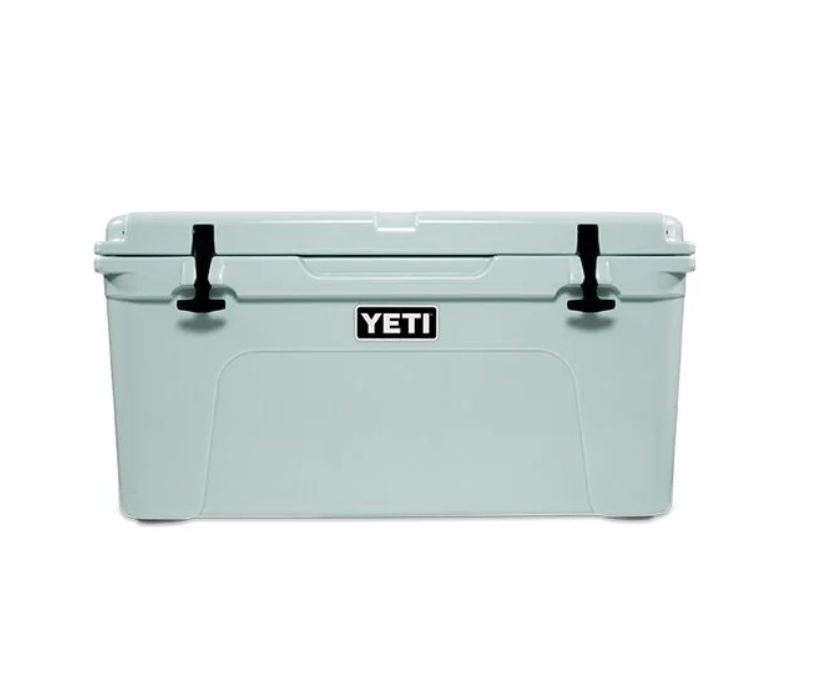 """<p><strong>Yeti</strong></p><p>rei.com</p><p><strong>$349.98</strong></p><p><a href=""""https://go.redirectingat.com?id=74968X1596630&url=https%3A%2F%2Fwww.rei.com%2Fproduct%2F852554&sref=https%3A%2F%2Fwww.goodhousekeeping.com%2Ftravel-products%2Fg2137%2Fbest-coolers%2F"""" rel=""""nofollow noopener"""" target=""""_blank"""" data-ylk=""""slk:Shop Now"""" class=""""link rapid-noclick-resp"""">Shop Now</a></p><p>Yeti has emerged as an ultra-trendy and reliable premium brand that makes high-quality products – the Tundra 65 rotomolded cooler is no exception. The Tundra 65 has <strong>two-inch thick foam-insulated walls, replaceable rubber latches</strong><strong> that are easy to use, </strong>molded tie-down slots, lock holes, and easy-to-grip rope handles. </p><p>The cooler is sturdy enough to hold a """"<a href=""""http://igbconline.org/wp-content/uploads/2020/02/200220_Certified_Products_List.pdf"""" rel=""""nofollow noopener"""" target=""""_blank"""" data-ylk=""""slk:grizzly-resistant"""""""" class=""""link rapid-noclick-resp"""">grizzly-resistant""""</a> certificate, which is rewarded by an independent organization that tests coolers against bears trying to access its contents. The non-slip base keeps it from sliding around in transit and the drain is slightly sloped for a quick water release. To fit every need and preference, the Tundra line is available in five colors and 11 (!) sizes that can hold 21 cans up to 259 cans with ice. The Tundra 65 claims to hold about 42 cans with ice. </p><p>Our testers also like the newly released and reasonably priced <a href=""""https://go.redirectingat.com?id=74968X1596630&url=https%3A%2F%2Fwww.yeti.com%2Fen_US%2Fcoolers%2Fhard-coolers%2Froadie-24%2F10022160000.html&sref=https%3A%2F%2Fwww.goodhousekeeping.com%2Ftravel-products%2Fg2137%2Fbest-coolers%2F"""" rel=""""nofollow noopener"""" target=""""_blank"""" data-ylk=""""slk:Roadie 24"""" class=""""link rapid-noclick-resp"""">Roadie 24</a>. It is made with the same rotomolding technology as the Tundra 65. It is light (about 13 pounds), small enough to comfortably fit behind """