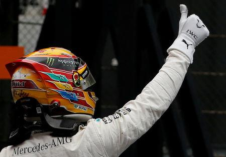 Formula One F1 - Japanese Grand Prix 2017 - Suzuka Circuit, Japan - October 7, 2017. Mercedes' Lewis Hamilton of Britain celebrates after getting pole position in qualifying. REUTERS/Toru Hanai