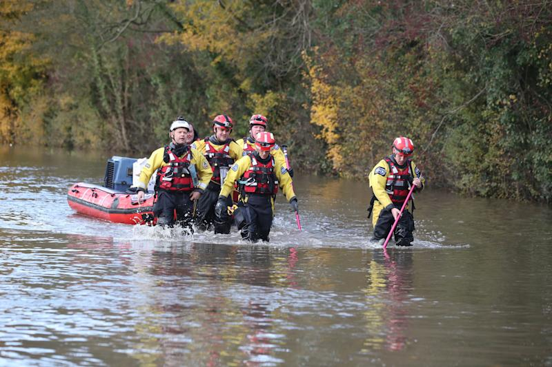 <strong>Rescuers pull a boat through floodwater in Fishlake, Doncaster</strong> (Photo: PA Wire/PA Images)