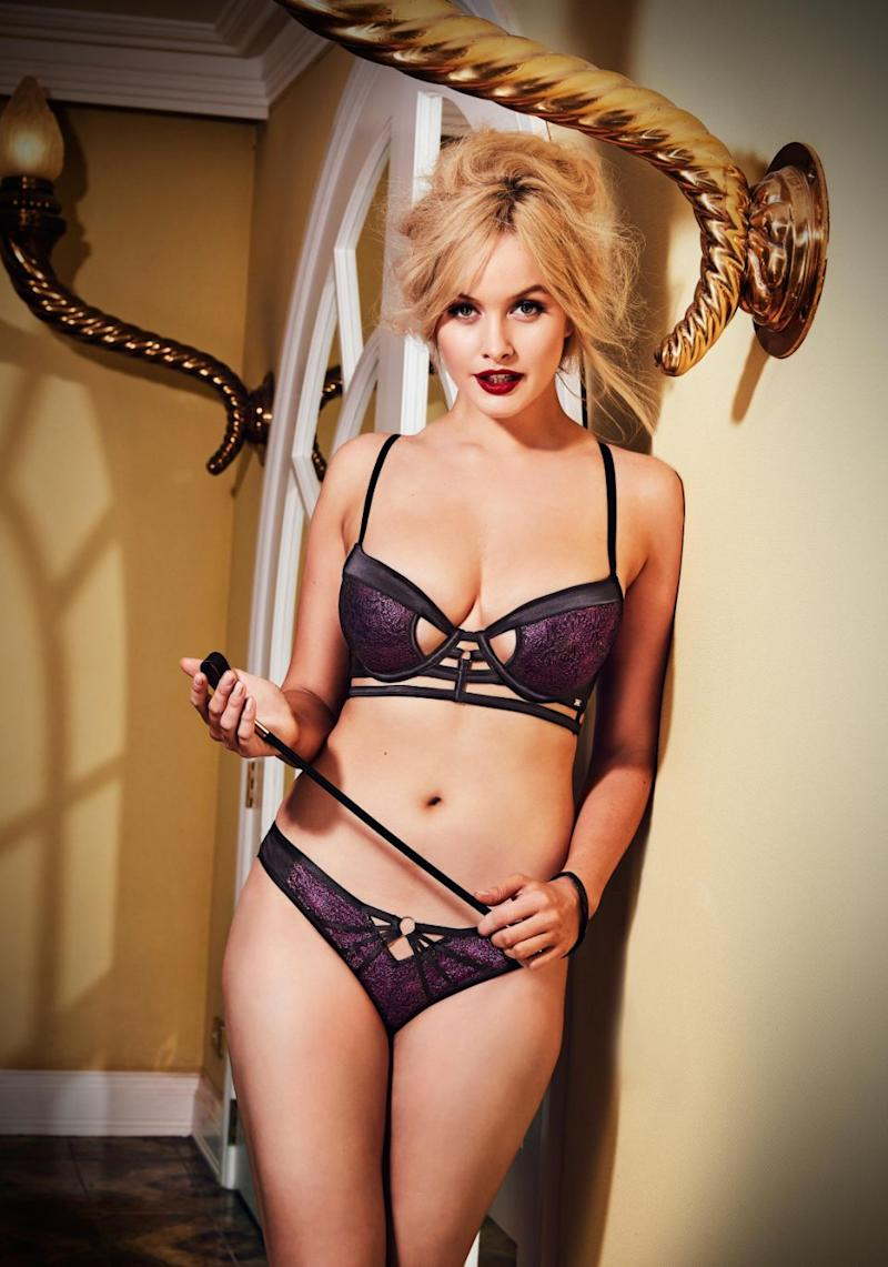 Simone even shows off a hint of her dominatrix side, posing in a sultry purple bra and panty set with a small whip in hand. Source: Bras N Things