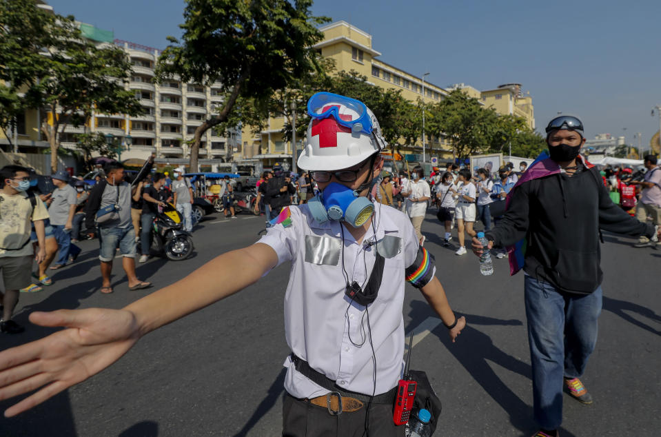 A high school student, with duct tape concealing ID tags on his school uniform, marches in front lines during a street protest close to the Democracy Monument in Bangkok, Thailand, Saturday, Nov. 14, 2020. (AP Photo/Sakchai Lalit)