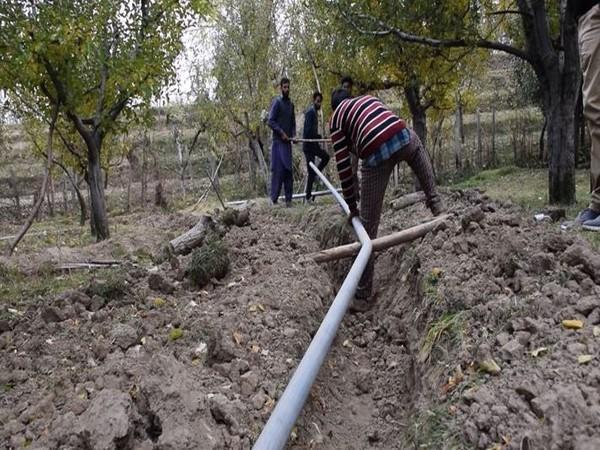 Installation of new water pipes in a village of Shopian district underway. (Photo/ANI)