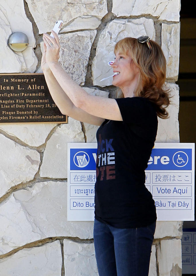 Kathy Griffin takes a picture of herself outside a Los Angeles polling station.  Kathy urged followers on Twitter to show her where they put their 'I VOTED' sticker after tweeting a pic of herself proudly wearing it on her nose. Kathy wore a 'Rock The Vote' t-shirt.