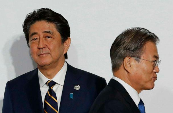 PHOTO: In this June 28, 2019, file photo, South Korean President Moon Jae-in, right, walks by Japanese Prime Minister Shinzo Abe upon his arrival for a welcome and family photo session at the G-20 leaders summit in Osaka, western Japan. (Kim Kyung-hoon/Pool Photo via AP, FILE)