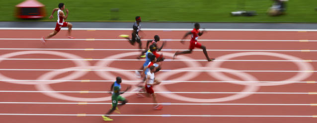 United States' Justin Gatlin, right, leads in a men's 100-meter heat during the athletics in the Olympic Stadium in the Olympic Park during the 2012 Summer Olympics in London, Saturday, Aug. 4, 2012. (AP Photo/Mark J. Terrill)