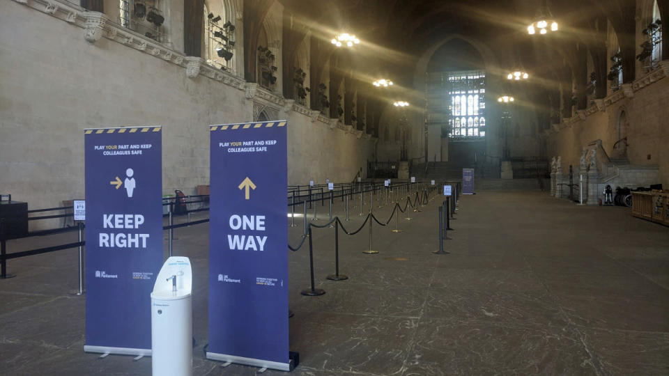 The queuing system which has been put in place at Westminster Hall in the Palace of Westminster for MPs to line up for the vote on the government's plans to force all MPs to vote in person, in London, Tuesday June 2, 2020. Like many other Britons, U.K. lawmakers have largely been working from home during the coronavirus pandemic. Now they are being summoned back to the office and many aren't happy. They say the government's decision to scrap a remote-voting system used during the pandemic will turn those who must stay home because of age, illness or family issues into second-class lawmakers. (George Ryan/PA via AP)