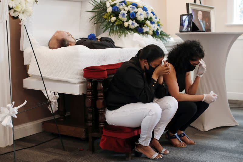 Viewing service of Jose Holguin, 50, who died of complications related to coronavirus disease (COVID-19) in Manhattan, New York City
