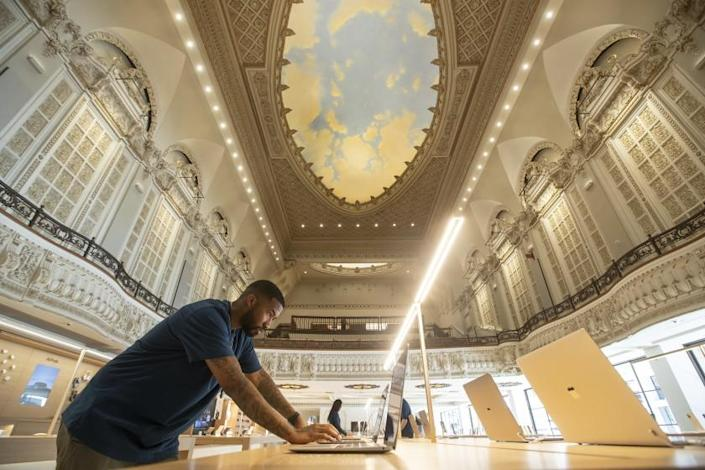 LOS ANGELES, CA - JUNE 23, 2021: 7 WillIams, a creative for Apple, works inside the Apple Tower Theatre on Broadway in downtown Los Angeles that is ready to open after a three-year renovation and conversion of the historic Tower Theater, built in 1927, the first movie palace in Los Angeles to be equipped for talkies. View above shows a portion of the atmospheric dome ceiling. (7 is his actual first name) (Mel Melcon / Los Angeles Times)