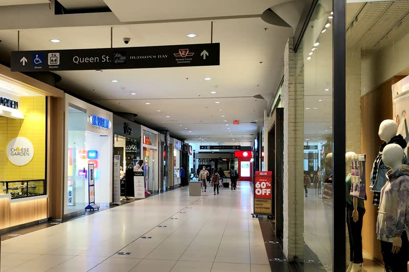 A relatively small number of shoppers walk in Eaton Centre in downtown Toronto