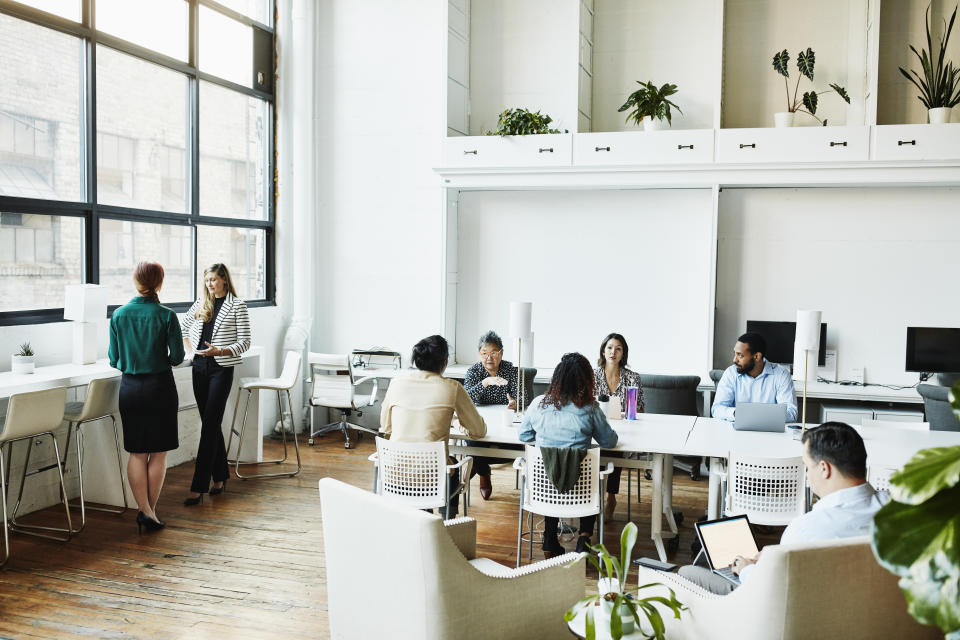 Businesspeople working in coworking office