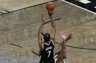 Brooklyn Nets' Kevin Durant (7) shoots over Milwaukee Bucks' P.J. Tucker to tie Game 7 in the second half during a second-round NBA basketball playoff series Saturday, June 19, 2021, in New York. (AP Photo/Frank Franklin II)
