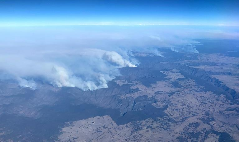 Climate scientists are currently examining data from the disaster, which saw swathes of southeastern Australia destroyed, to determine to what extent they can be attributed to rising temperatures (AFP Photo/TOM BANNIGAN)