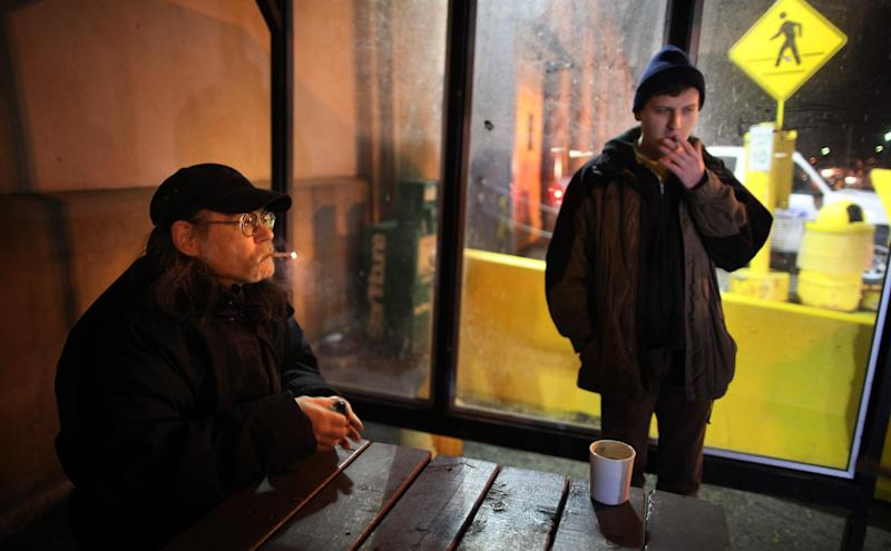 Don Lemmons,  and Andy Melby smoke a cigarette before their last shift at the Ford plant on  Friday, Dec. 16, 2011 in St. Paul, Minn.  The Ford Motor Company plant in St. Paul is closing after 86 years. The last vehicle is expected to roll off the line today at the auto-making site. A group of area residents are planning to gather outside the plant to cheer the 800 remaining employees and mark the end of an era. (AP Photo/The Star Tribune, Brian Peterson)  MANDATORY CREDIT; ST. PAUL PIONEER PRESS OUT; MAGS OUT; TWIN CITIES TV OUT