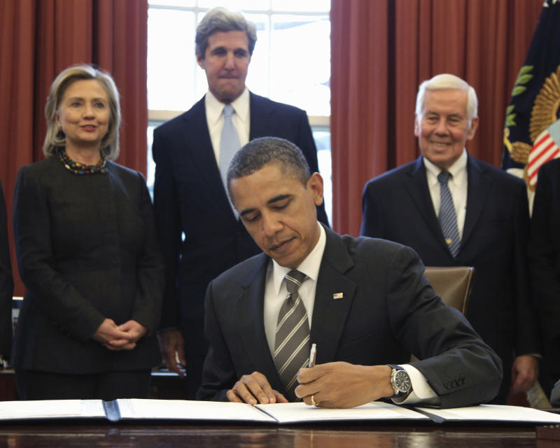 President Barack Obama signs the New START Treaty in the Oval Office of the White House in Washington, Wednesday, Feb. 2, 2011. Looking on, from left are, Secretary of State Hillary Rodham Clinton, Senate Foreign Relations Committee Chairman Sen. John Kerry, D-Mass., and the committee's ranking Republican Sen. Richard Lugar, R-Ind. (AP Photo/Carolyn Kaster)