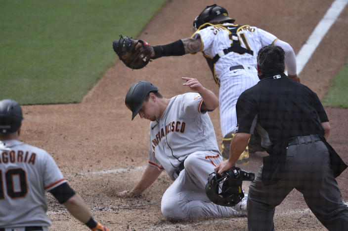 San Francisco Giants' Alex Dickerson slides into home ahead of the tag by San Diego Padres catcher Luis Campusano for the go-ahead score during the 10th inning of a baseball game in San Diego, Wednesday, April 7, 2021. The Giants won 3-2. (AP Photo/Kelvin Kuo)