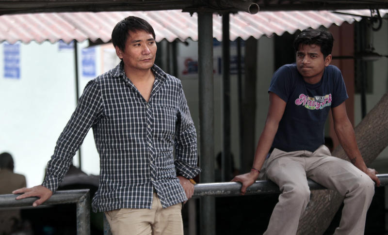 Sonam Wangyal, left, a Tibetan relative of Jampa Yeshi who immolated himself, waits with his friends outside a hospital where Yeshi is being treated in New Delhi, India, Tuesday, March 27, 2012. Yeshi, who remains in critical condition, lit himself on fire and ran shouting through a protest in the Indian capital Monday, just ahead of a visit by China's president Hu Jintao for an economic summit. (AP Photo/ Manish Swarup)