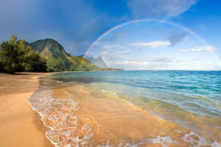 <p>Tunnels beach in Kauai, Hawaii has pretty much everything to make a picture perfect vista. There are mountain views, sandy beach, ocean and even rainbows (on a good day.)</p>
