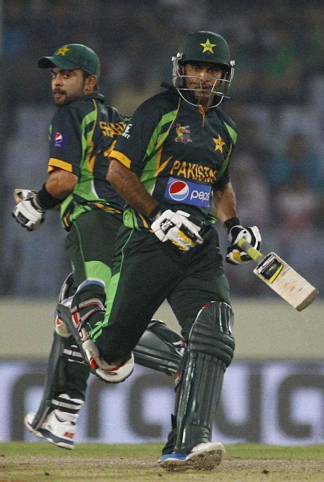 Pakistan's Mohammad Hafeez, right, and Ahmed Shehzad run between the wickets during their match against Bangladesh in the Asia Cup one-day international cricket tournament in Dhaka, Bangladesh, Tuesday, March 4, 2014. (AP Photo/A.M. Ahad)