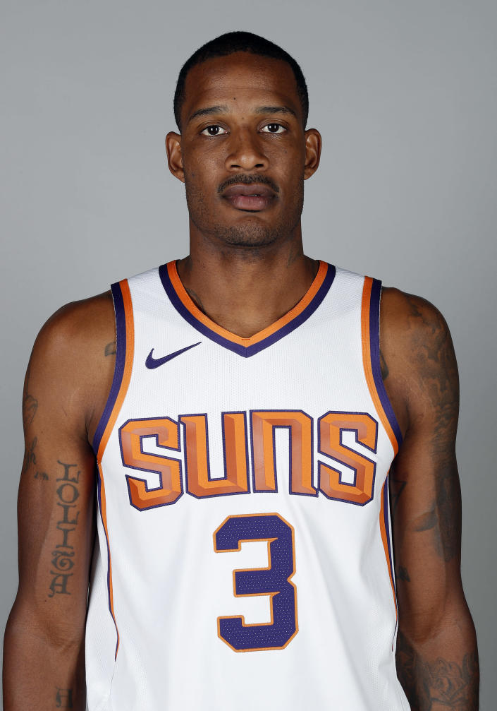 File-This photo taken Sept. 24, 2018, shows Phoenix Suns' Trevor Ariza posing for a photograph during media day at the NBA basketball team's practice facility in Phoenix. A person familiar with the deal says the Washington Wizards have an agreement in principle to acquire Ariza from the Phoenix Suns for Kelly Oubre Jr. and Austin Rivers. The person spoke to The Associated Press on condition of anonymity Saturday, Dec. 15, 2018, because it had not been announced by either team. (AP Photo/Matt York, File)