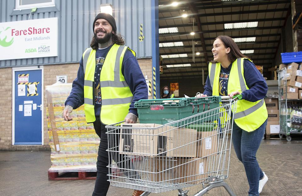 EMBARGOED TO 0001 MONDAY DECEMBER 21 EDITORIAL USE ONLY Vicky Pattison and Pete Wicks visit a FareShare facility in the East Midlands to see how food, donated in partnership with McDonald's, is sorted and distributed to families in need this Christmas.