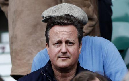 Former Prime Minister of Great Britain David Cameron in the stands before the match