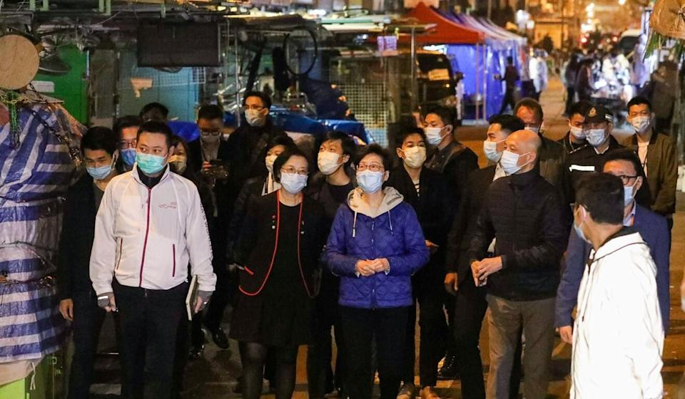 Chief Executive Carrie Lam (in purple) and health minister Sophia Chan at the Sham Shui Po lockdown zone. Photo: May Tse