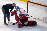 New York Rangers goaltender Keith Kinkaid drops to a knee after an apparent injury, after making a save on a shot by Boston Bruins right wing David Pastrnak, during the third period of an NHL hockey game, Saturday, May 8, 2021, in Boston. (AP Photo/Charles Krupa)