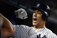New York Yankees' Aaron Judge celebrates his solo home run during the first inning of a baseball game against the Boston Red Sox on Sunday, Aug. 4, 2019, in New York. (AP Photo/Adam Hunger)