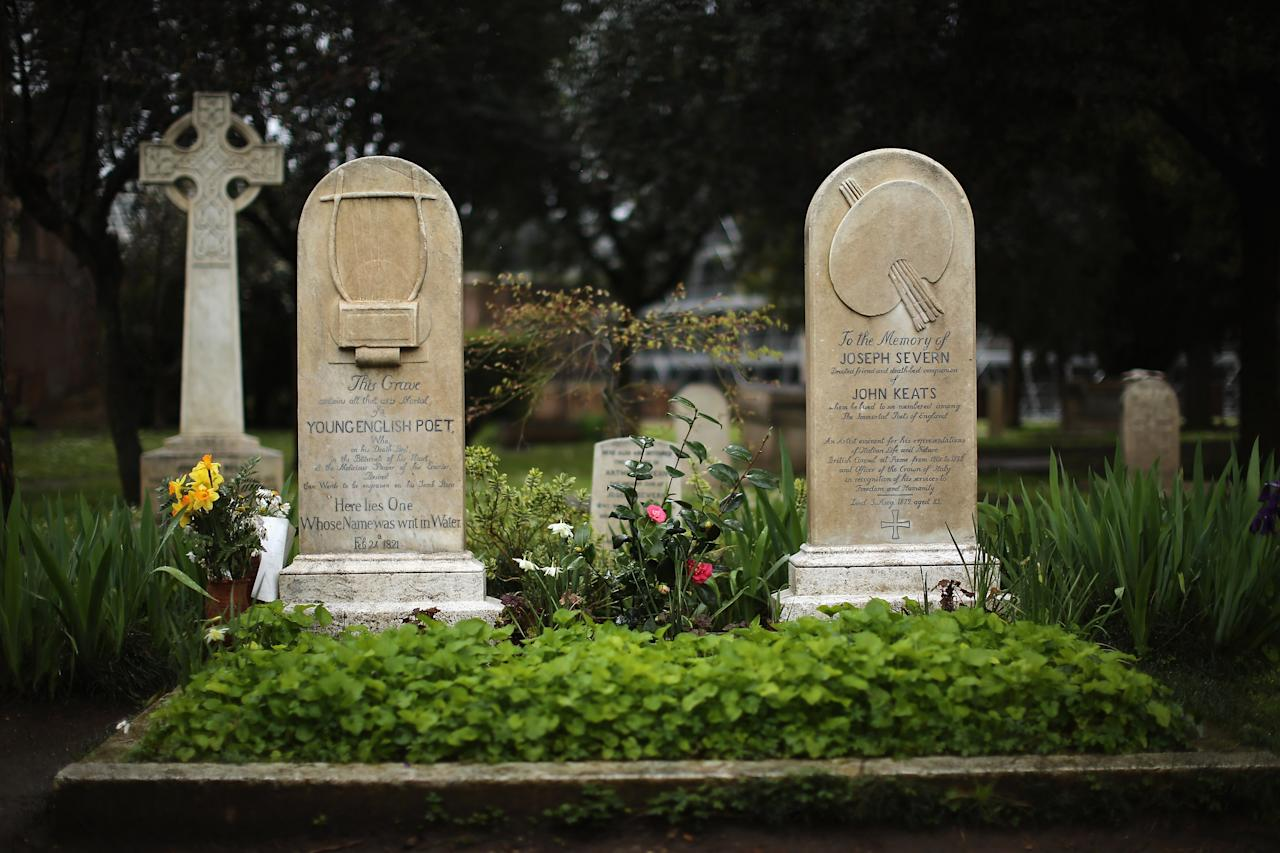 ROME, ITALY - MARCH 26:  The gravestones of poet John Keats, (1795-1821), (L) and painter and friend Joseph Severn, (1803-79) stan in Rome's 'Non Catholic Cemetery' on March 26, 2013 in Rome, Italy. John Keats, one of England's most famous poets died early in 1820 of tuberculosis aged 25, after travelling to Italy in search of a better climate to help cure him of the disease. Rome's Non-Catholic Cemetery contains one of the highest densities of famous and important graves anywhere in the world. It is the final resting-place of the poets Percy Shelley and John Keats, as well as many other painters, sculptors and authors who died in Rome. The cemetery which began it's use in 1730 continues today, containing graves of Orthodox Christians, Jews, Muslims and other non-Christians, and is one of the oldest burial grounds in Europe.  (Photo by Dan Kitwood/Getty Images)