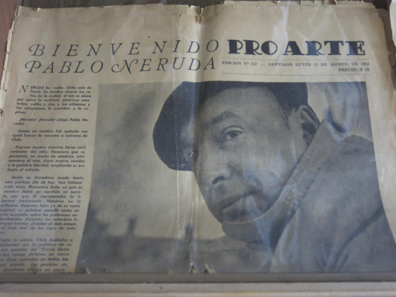 The copy of an old newspaper featuring Chile's Nobel-Prize winning poet Pablo Neruda is seen in his home in Santiago, Chile, Friday, Nov. 8, 2013. The four-decade mystery of whether Neruda was poisoned was seemingly cleared up on Friday, when forensic test results showed no chemical agents in his bones. But his family and driver were not satisfied and said they'll request more proof. (AP photo/Luis Andres Henao)