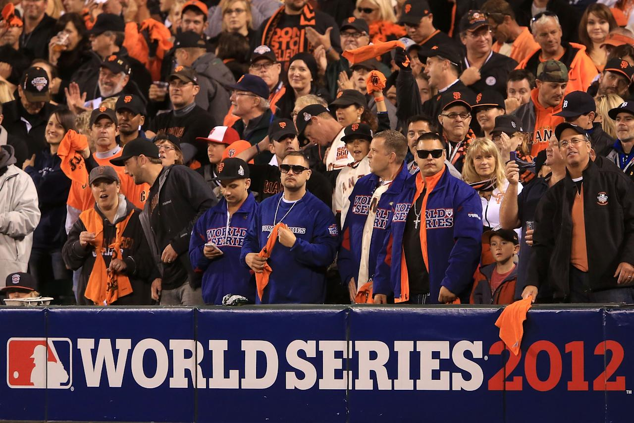 SAN FRANCISCO, CA - OCTOBER 24:  Fans stand and cheer behind a World Series sign as the San Francisco Giants host the Detroit Tigers during Game One of the Major League Baseball World Series at AT&T Park on October 24, 2012 in San Francisco, California.  (Photo by Doug Pensinger/Getty Images)