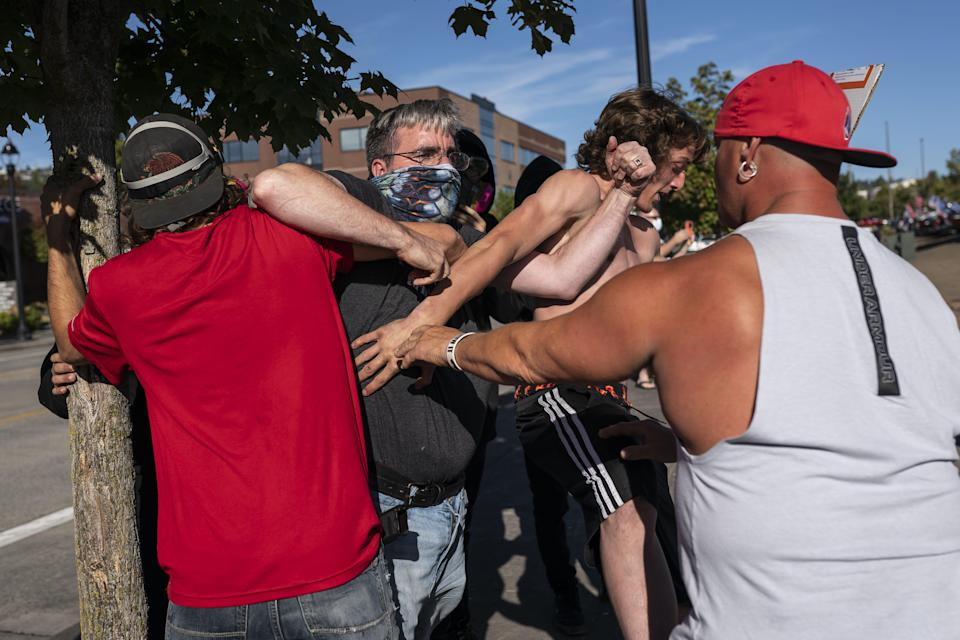 A Black Lives Matter protester scuffles with pro-Trump demonstrators Aug. 29 in Clackamas, Oregon.