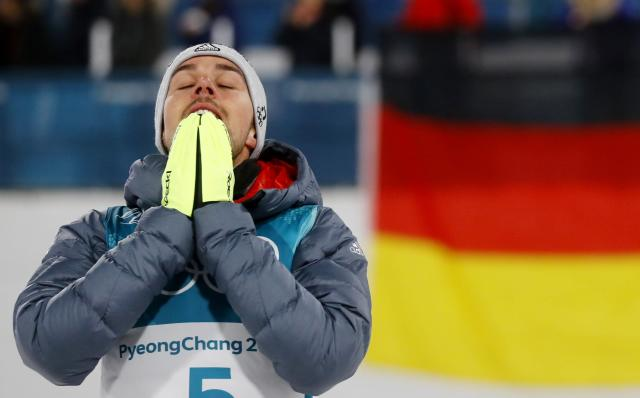 Nordic Combined Events - Pyeongchang 2018 Winter Olympics - Men's Individual 10 km Final - Alpensia Cross-Country Skiing Centre - Pyeongchang, South Korea - February 20, 2018 - Gold medalist, Johannes Rydzek of Germany reacts during the victory ceremony. REUTERS/Kai Pfaffenbach