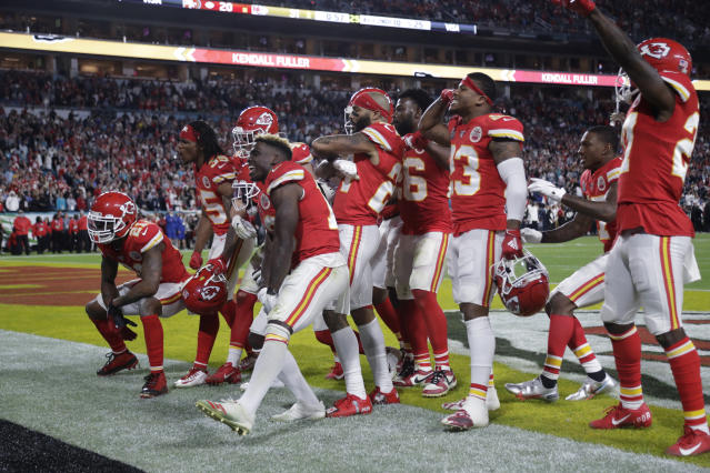 Kansas City Chiefs players celebrate during the second half of the NFL Super Bowl 54 football game against the San Francisco 49ers Sunday, Feb. 2, 2020, in Miami Gardens, Fla. The Kansas City Chiefs won 31-20. (AP Photo/Wilfredo Lee)