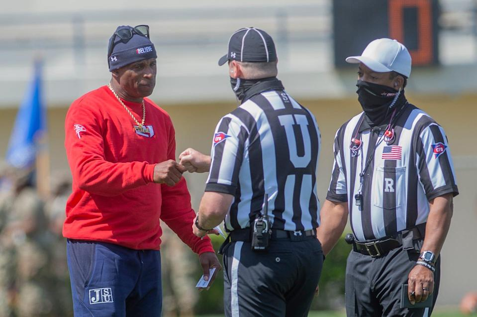 Coach Deion Sanders spoke with the officials during pregame warm-ups before Jackson State's April 3 home game against Southern.