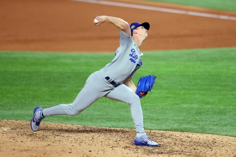 Los Angeles Dodgers ace Walker Buehler delivers a pitch against the Tampa Bay Rays during the fifth inning in game three of the World Series at Globe Life Field in Arlington, Texas