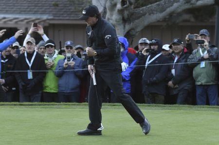 Feb 10, 2019; Pebble Beach, CA, USA;  Phil Mickelson celebrates his birdie at the 15th hole during the final round of the AT&T Pebble Beach Pro-Am golf tournament at Pebble Beach Golf Links. Mandatory Credit: Michael Madrid-USA TODAY Sports